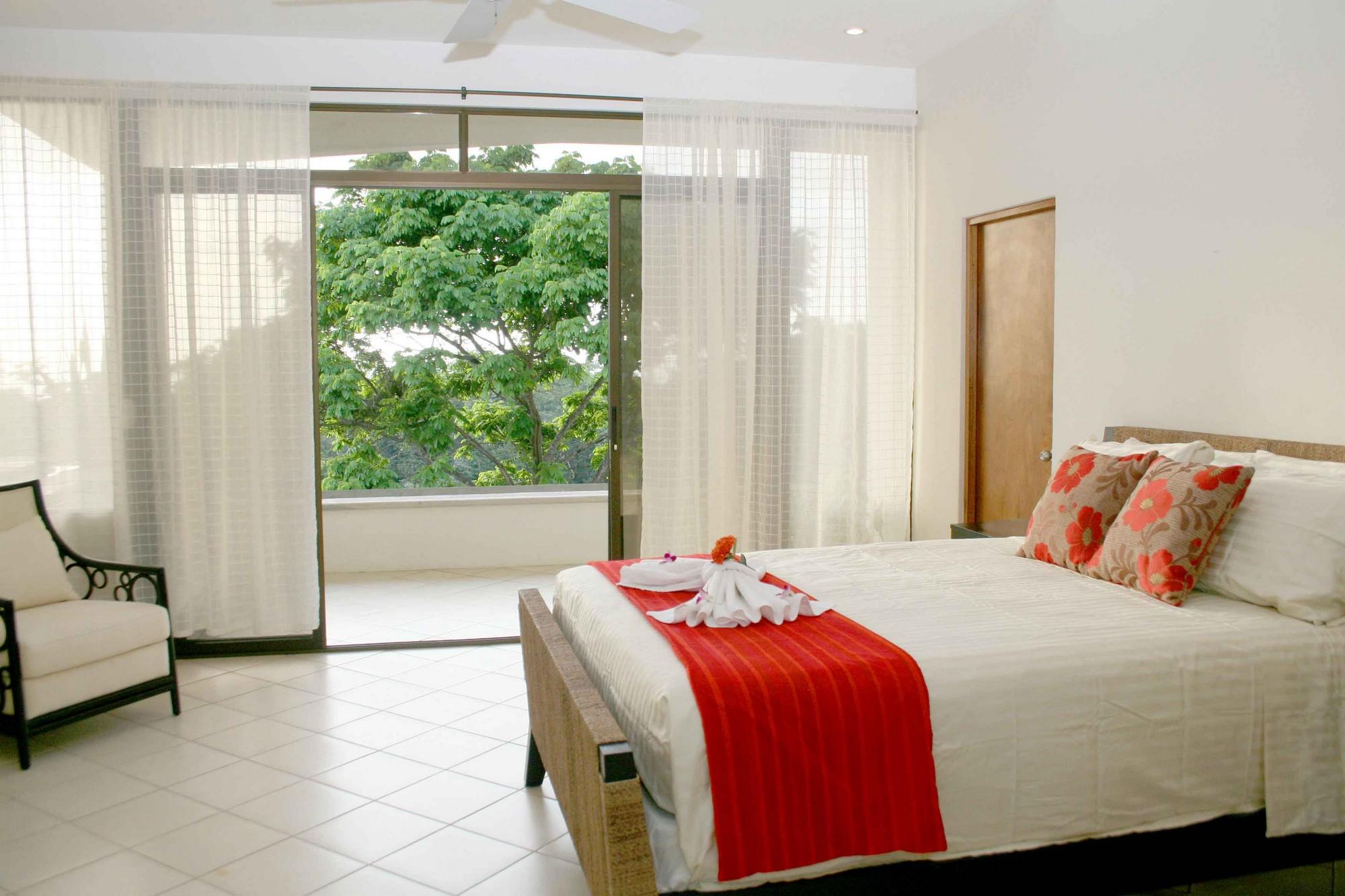 Casa de las Cascadas, Manuel Antonio, Costa Rica The upper guest and master bedrooms are accessed via an outdoor walkway.