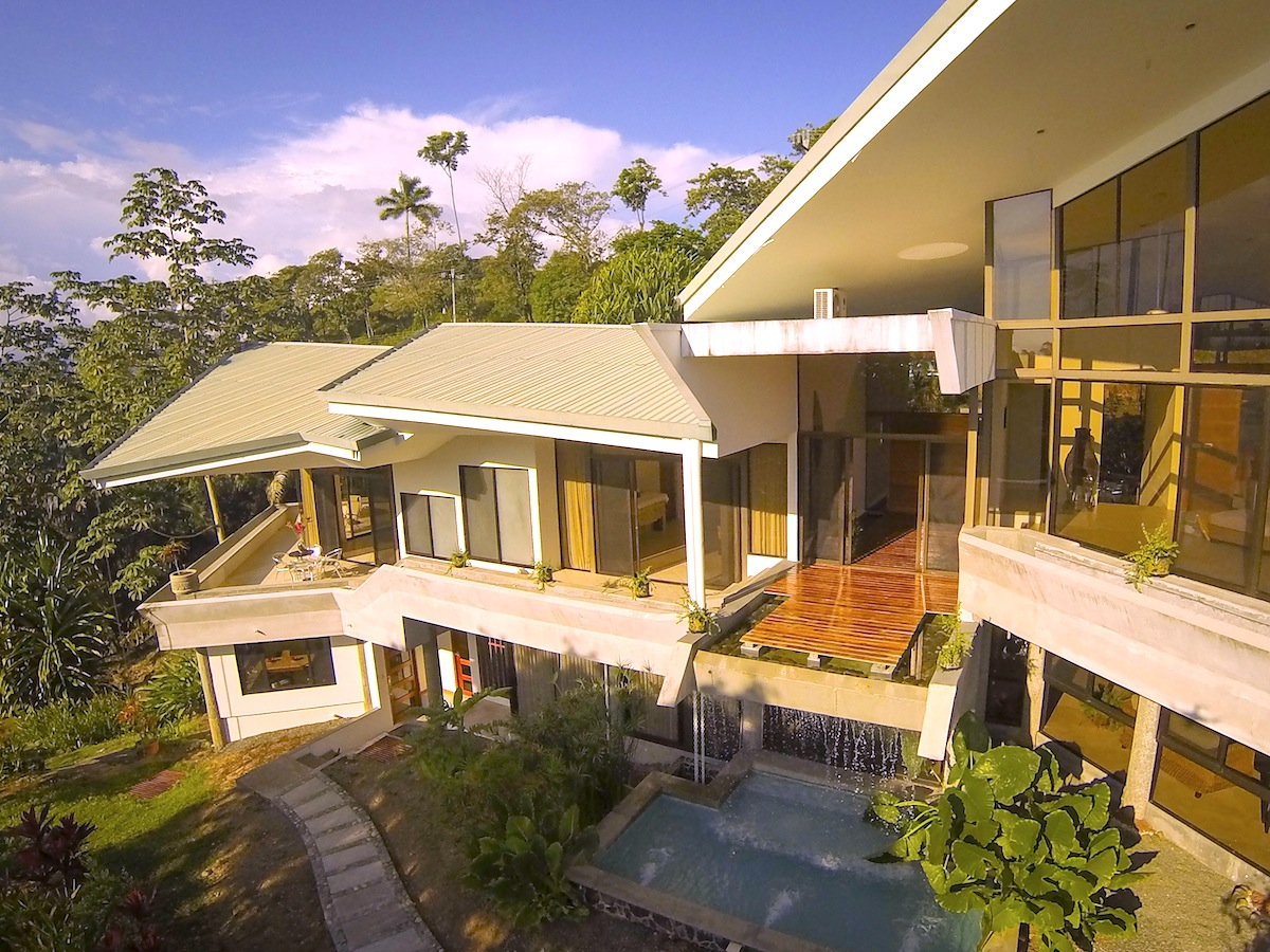 Casa de las Cascadas, Manuel Antonio, Costa Rica Aerial of the waterfall and path to apartment.