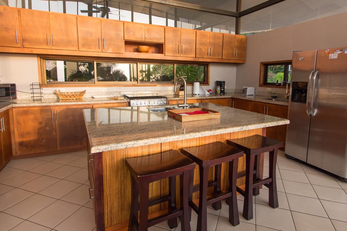 Casa de las Cascadas, Manuel Antonio, Costa Rica Great kitchen with gas stove & island.